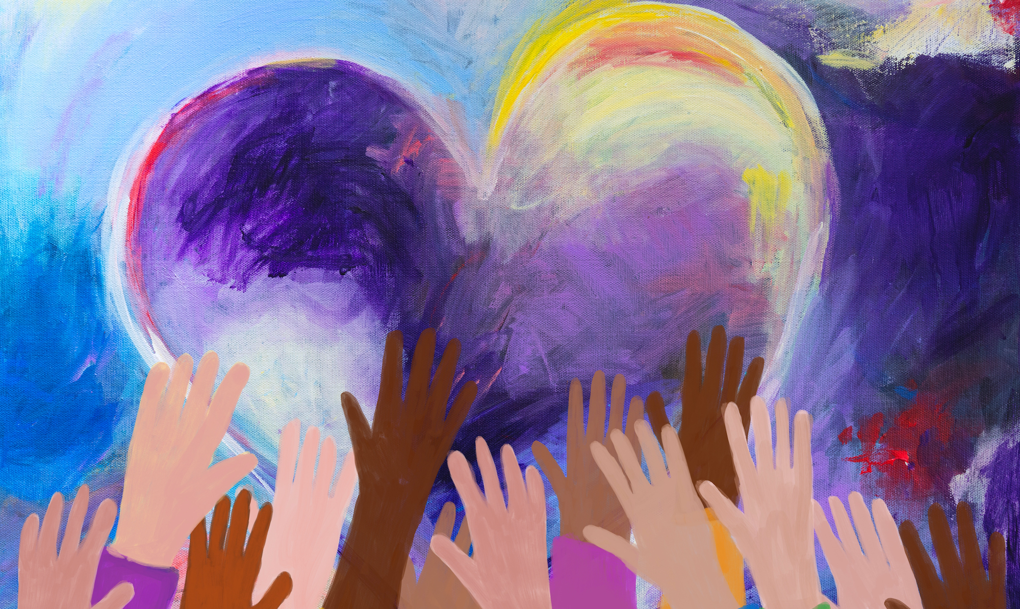 Diverse hands reaching for giant heart