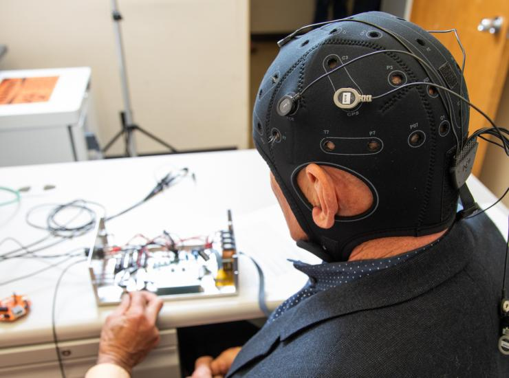 Researchers prepare EEG equipment for a study