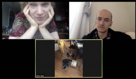 Two people and a cat on a zoom call